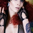Razor Candi in 'Busty Tattooed Razor Candi with Big Curly Red Hair'